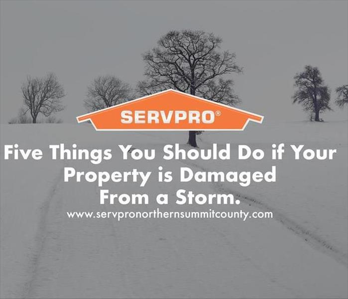 Orange SERVPRO  house logo on image with  snow storm in background