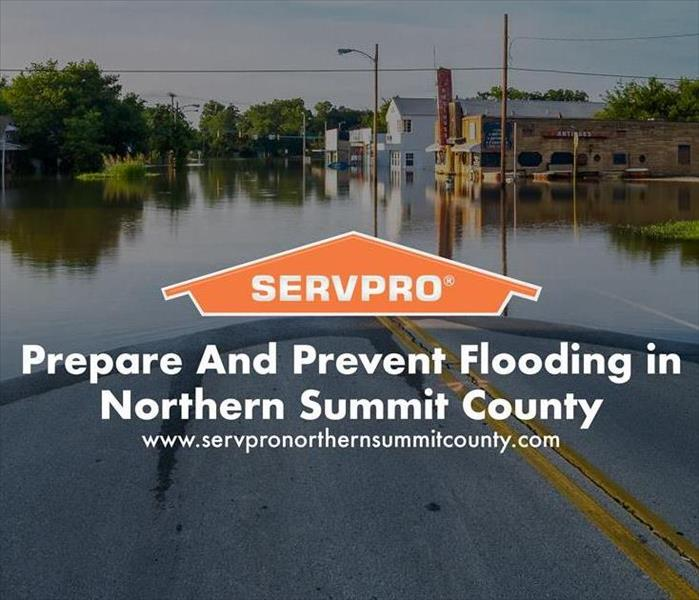Orange SERVPRO  house logo on image with flooding on road.