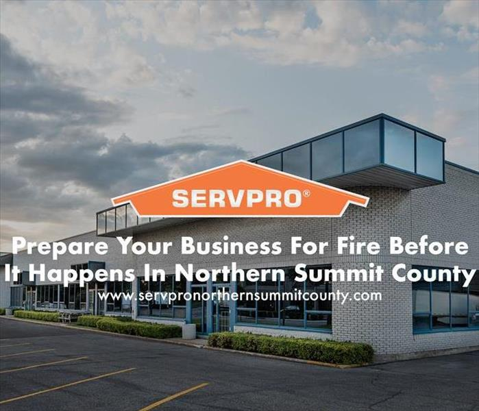Orange SERVPRO  house logo on image with business.