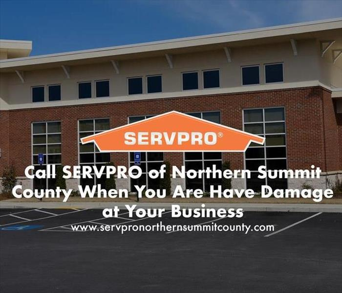 Orange SERVPRO  house logo on image with business building.