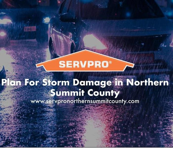 Orange SERVPRO house logo on image with rain storm in background