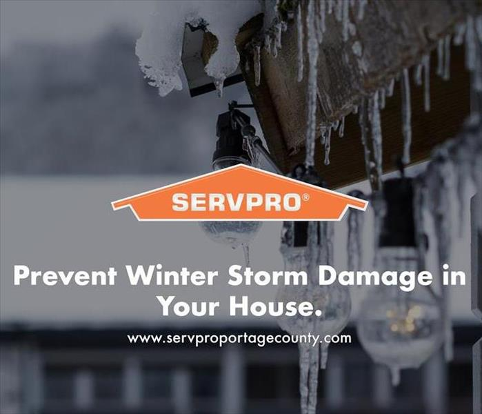 Orange SERVPRO  house logo on image with home that has icicles.